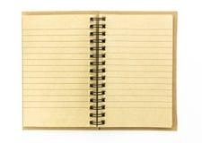打开在白色背景隔绝的棕色笔记本 库存图片