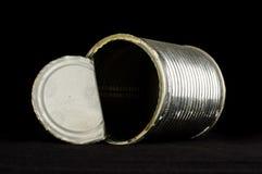 打开在黑背景的锡罐 免版税库存照片