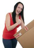 打开小包的激动的妇女 免版税库存图片