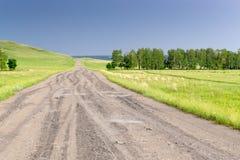 打开村庄石路和领域 库存图片