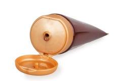 打开棕色奶油色管 免版税库存照片