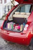 打开汽车的后车箱有袋子的购买 库存图片