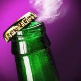 打开瓶在紫色的啤酒 免版税库存照片