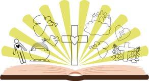 打开用不同的图片和光芒的圣经 免版税库存图片