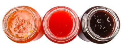 打开盒盖被装瓶的蓝莓,草莓,橙色果酱VI 免版税库存图片