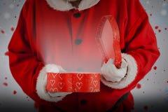 打开礼物盒的圣诞老人的综合图象 库存图片