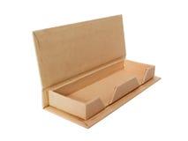 打开纸板箱,与裁减路线的成套设计在白色 图库摄影