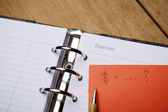 打开议程和预算费用概念 免版税库存图片