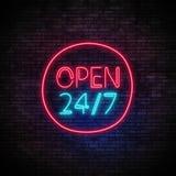 打开24 7个小时在砖墙上的霓虹灯 库存图片