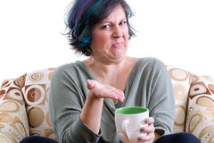 打手势到茶的恶心的妇女 库存照片