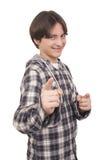 英俊微笑的少年打手势 免版税图库摄影
