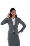 打手势好手标志的女实业家 免版税库存照片