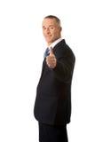 打手势好标志的成熟商人 免版税库存图片