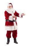打手势对边的圣诞老人 免版税图库摄影