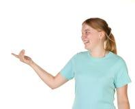 打手势少年的女孩 库存图片