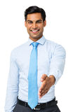 打手势握手的愉快的商人 免版税图库摄影