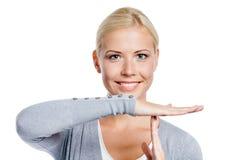 打手势时间的妇女画象  免版税库存图片