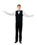 打手势欢迎的年轻英俊的侍者 免版税图库摄影