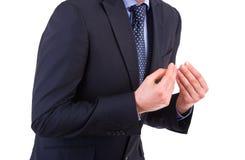 打手势用两只手的商人。 免版税图库摄影