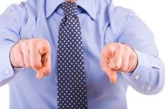 打手势用两只手的商人。 免版税库存照片