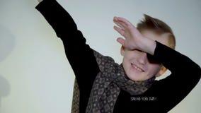 打手势用手的小滑稽的男孩在白色背景的照相机 股票录像