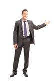 打手势用他的手的快乐的商人 库存图片