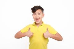 打手势赞许的快乐的男孩 图库摄影