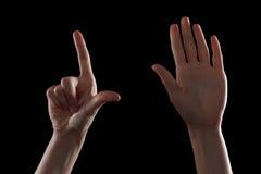 打手势,少妇的手表明方向或接触设备 免版税库存照片
