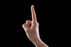 打手势,少妇的手表明方向或接触设备 免版税图库摄影