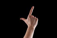 打手势,少妇的手表明方向或接触设备 图库摄影