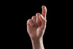 打手势,少妇的手表明方向或接触设备 库存照片