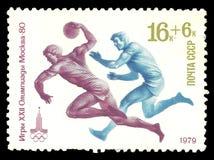 打手球的运动员 免版税图库摄影