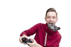 打电子游戏的年轻人滑稽 免版税库存照片