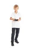 打电脑游戏的男孩 免版税图库摄影