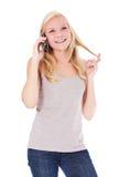 打电话的可爱的妇女 免版税库存照片