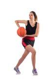 打篮球的妇女隔绝在白色 库存照片