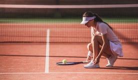 打网球的女孩 图库摄影