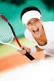 打网球的运动装的女运动员 库存图片