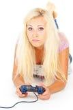 打计算机游戏的女孩 库存图片