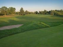 打高尔夫球的日落 库存图片