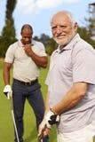 打高尔夫球的老人 图库摄影