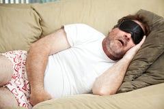打鼾的终日懒散在家的人 免版税库存照片