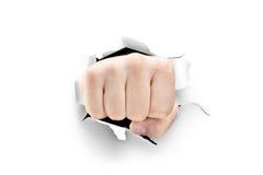 打破白皮书的男性拳头 免版税库存照片