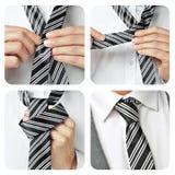 打结他的一个人领带 库存照片