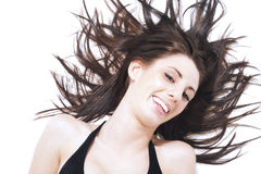 扔她的头发的笑的无忧无虑的妇女l 库存图片