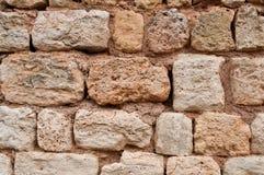 扔石头的墙壁纹理 免版税库存照片