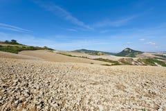 托斯卡纳的Plowed倾斜的小山 免版税库存图片