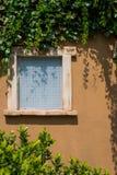 托斯卡纳窗口房子 库存图片