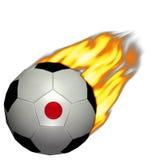 托起火橄榄球日本足球世界 库存照片