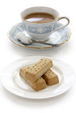 托起牛奶脆饼茶 库存图片